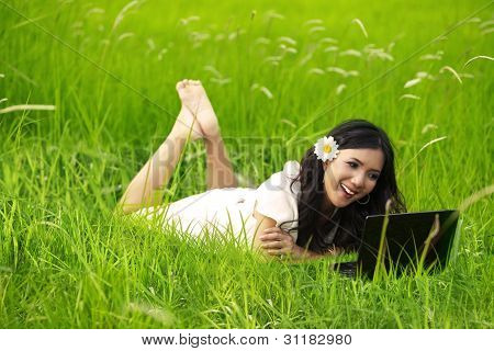 Happy Beautiful Woman Using Laptop Outdoor