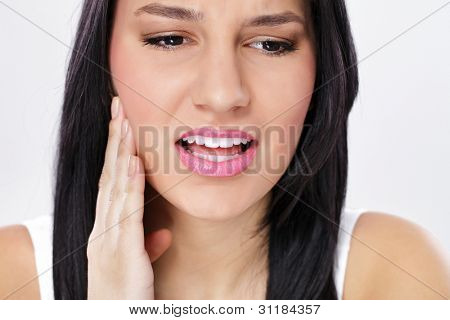 Young woman having tooth pain