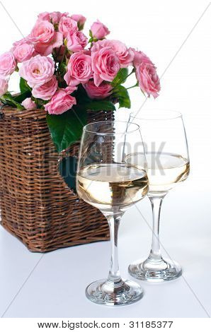 Two Glasses Of White Wine And Roses