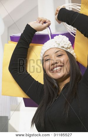 African American woman with shopping bags smiling