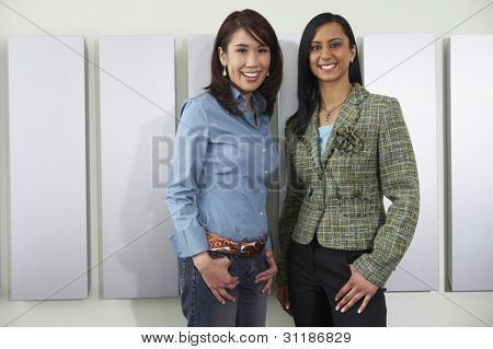 Two young women smiling at camera