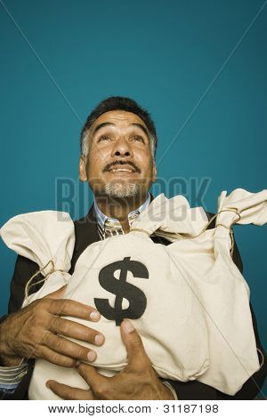 Man holding bags of money