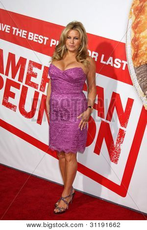 "LOS ANGELES - MAR 19:  Jennifer Coolidge  arrives at the ""American Reunion"" Premiere at the Grauman's Chinese Theater on March 19, 2012 in Los Angeles, CA"
