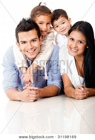 Beautiful family portrait lying on the floor and smiling