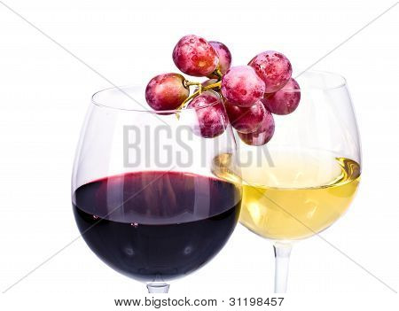 Pair Of Wine Glasses With Red And White Wine And Grapes