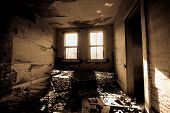 stock photo of abandoned house  - Abandoned house with a room with trash in it - JPG