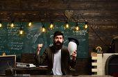 Genius Man With Beard Hold Bulb On Chalkboard. Genius Businessman With Lightbulb Got Idea In Classro poster