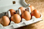 Seven Brown Chicken Eggs In A Carton Paper Packaging On A Kitchen Table. Eggs For Breackfast. Health poster
