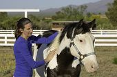 Woman Performs Equine Myofascial Release Technique On A Shoulder poster