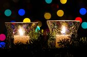 White Christmas Candles Surrounded By Christmas Lights And Evergreen Branches poster
