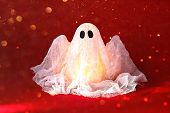 Halloween Ghost Of Starch And Gauze On Orange Background. Gift Idea, Decor Halloween. Process Kid Ch poster