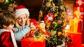 Happy Family. Mom And Kid Play Together Christmas Eve. My Dear Baby Santa. Mother And Little Child B poster