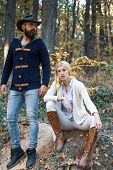 Fashion Autumn Couple On Fall Nature Background. Autumn Love Story - Portrait Couple In Love. Autumn poster