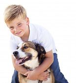 stock photo of mans-best-friend  - Handsome Young Boy Playing with His Dog Isolated on a White Background - JPG