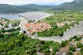 A View High Up From The Walls Of Ston Overlooking The Town Of Ston, Croatia.  The Wall Is An Ancient poster