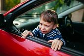 Crying Baby Boy In Car. The Boy Is Crying And Wants To Get Out Of The Maniche poster