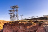 Power plant house and power line over Electricity generating dam in Page Arizona USA poster