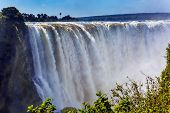Journey after the wet season. Grand and deep Victoria Falls after the rainy season. Victoria Nationa poster