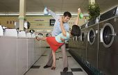 Couple dancing with soap in laundromat