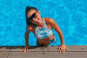 Fashion Portrait Of Beautiful Sexy Young Women In Swimming Pool. Cheerful Woman Shows Tongue poster