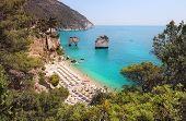 Summer Touristic Destination In Puglia, Italy: Faraglioni Di Puglia Baia Delle Zagare. Beach And Far poster