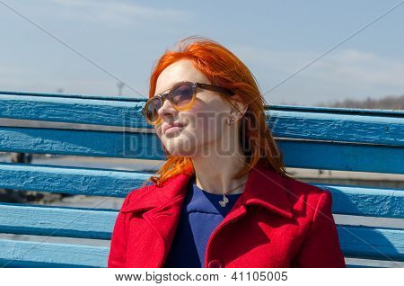 Red woman enjoying sunny day