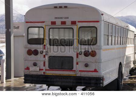 White School Bus Pumping Gas