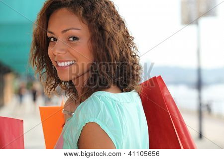 Woman enjoying lavish shopping trip