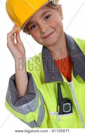 Little girl dressed in construction outfit