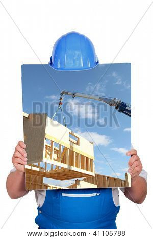 faceless worker showing a building site picture
