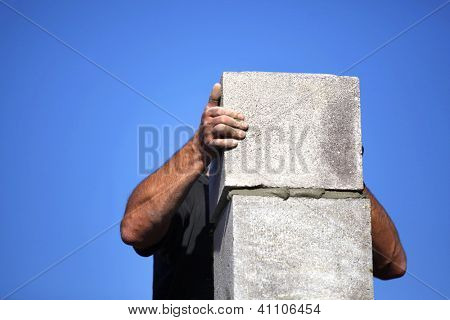 Builder creating a chimney stack