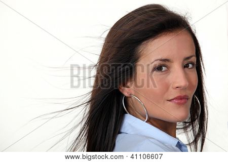 Brunette wearing hoop earrings