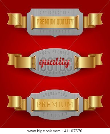 Decorative emblems of quality with golden ribbons