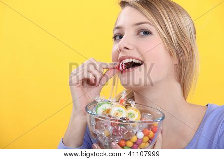 Woman eating candy