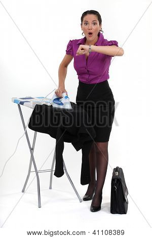 Multitasking woman looking at the time