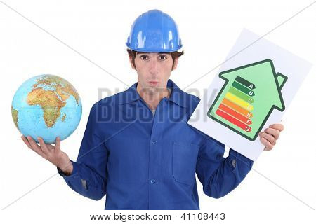 Man holding energy rating poster and globe