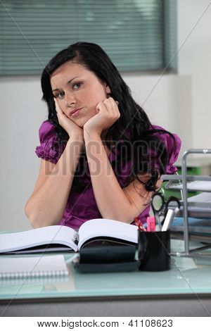 Woman behind her desk