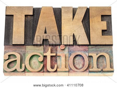 take action - motivation concept - isolated text in vintage letterpress wood type printing blocks
