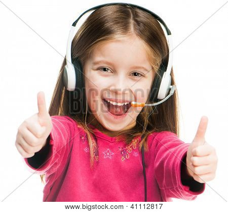 Smiling little girl in headset isolated over white with thumbs up