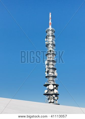 Communications Tower On A Snowy Mountain Peak