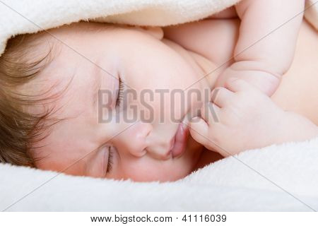 cute sleeping baby boy, beautiful kid's face closeup, studio shot
