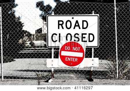 Road Closed Sign Before Chain Link Fence