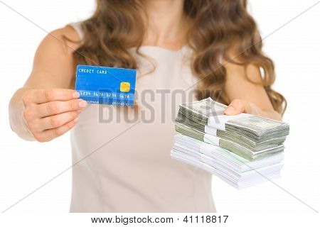 Closeup On Woman Giving Credit Card And Money Packs