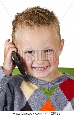 Boy Talking On A Cell Phone - Isolated