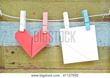 Paper Heart And Card Hanging On The Clothesline. On Old Wood Background.