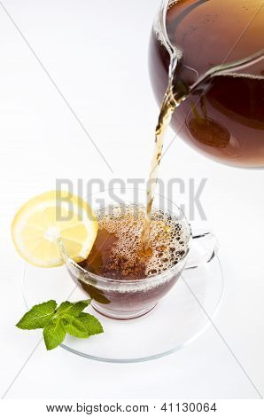 Hot tea with lemon and leaf mint