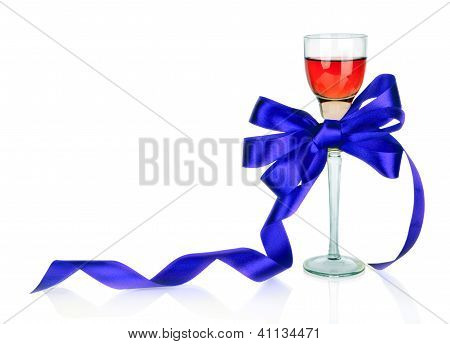 Wine In Wineglass And Blue Satin Gift Bow, Isolated On White