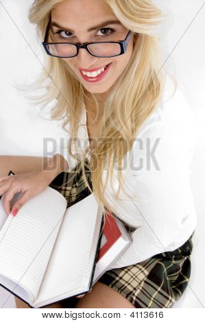 High Angle View Of Smiling Young Student Holding Books