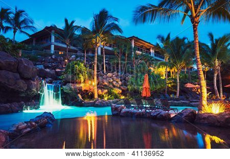 Tropical Resort Pool at Sunset in Hawaii