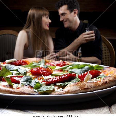 Couple enjoying pizza